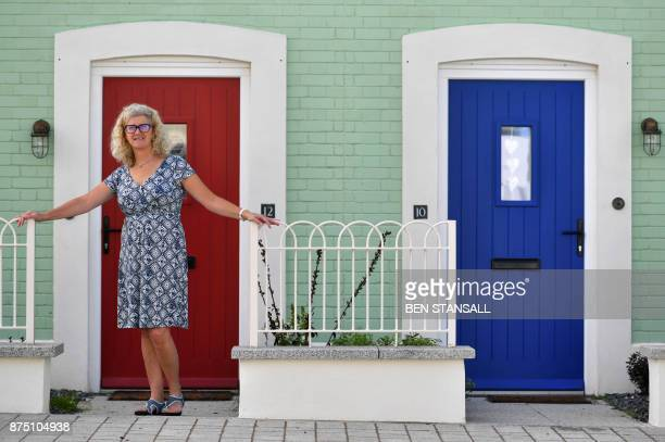 Resident Theresa Ferguson stands outside her home in Nansledan housing development championed by Britain's Prince Charles Prince of Wales at Newquay...