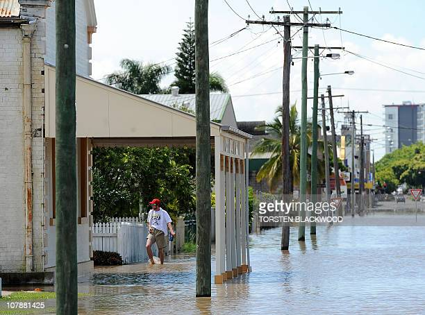 A resident tries to reach his flooded home after the Fitzroy River broke its banks and inundated much of Rockhampton on January 4 2011 Up to 200000...
