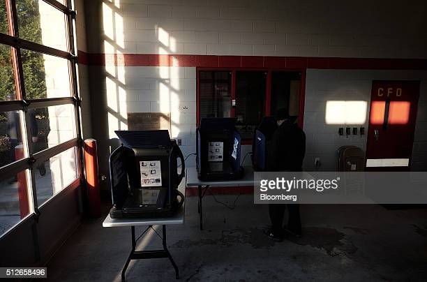 A resident votes in the South Carolina Democratic presidential primary election at a polling station inside the Shandon Fire Station in Columbia...