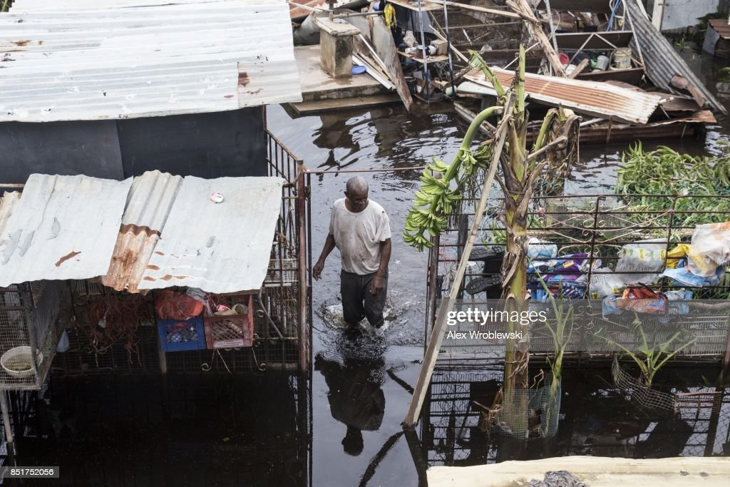 A resident wades through flood water days after Hurricane Maria made landfall, on September 22, 2017 in Loiza, Puerto Rico. Many on the island have lost power, running water, and cell phone service after Hurricane Maria, a category 4 hurricane, passed through.