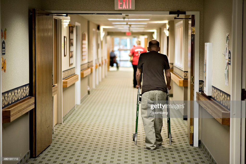 A resident walks in the hallway of Concord Care Center in Garner Iowa US on Thursday Oct 9 2014 Iowa state legislator Henry Rayhons is awaiting trial...