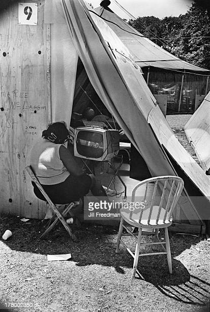 A resident watches television in her shelter at Resurrection City a three thousand person tent city on the Washington Mall set up as part of the Poor...