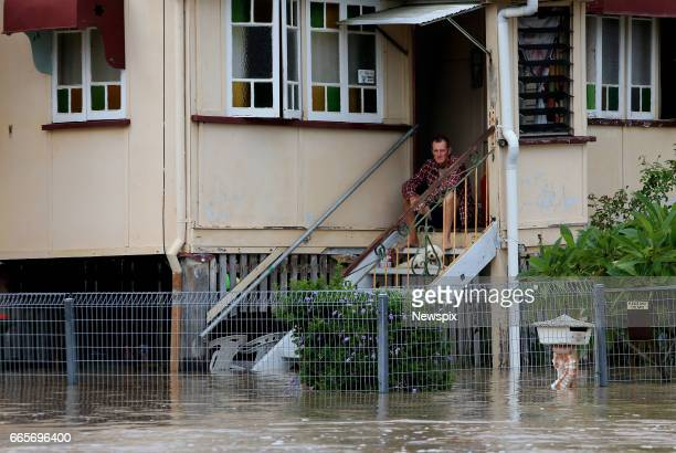 ROCKHAMPTON QLD A resident watches the rising floodwaters at Depot Hill in Rockhampton Queensland after the Fitzroy River burst its banks in the...
