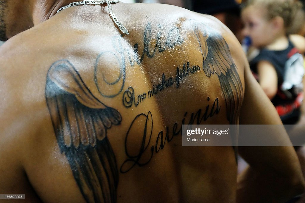 A resident wears a tattoo with the names of his daughters during a street carnival bloco in the Rocinha community, or favela, on March 2, 2014 in Rio de Janeiro, Brazil. Carnival is the grandest holiday in Brazil, annually drawing millions in raucous celebrations.