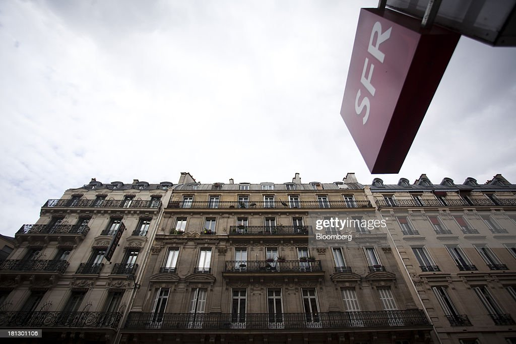 Residental apartments stand opposite an SFR store, a mobile-phone unit of Vivendi SA, in Paris, France, on Thursday, Sept. 19, 2013. Bank of France General Council member Bernard Maris said France will end up restructuring its debt as tax 'optimization' by large companies including Google Inc. will leave too big a burden on the middle class. Photographer: Balint Porneczi/Bloomberg via Getty Images