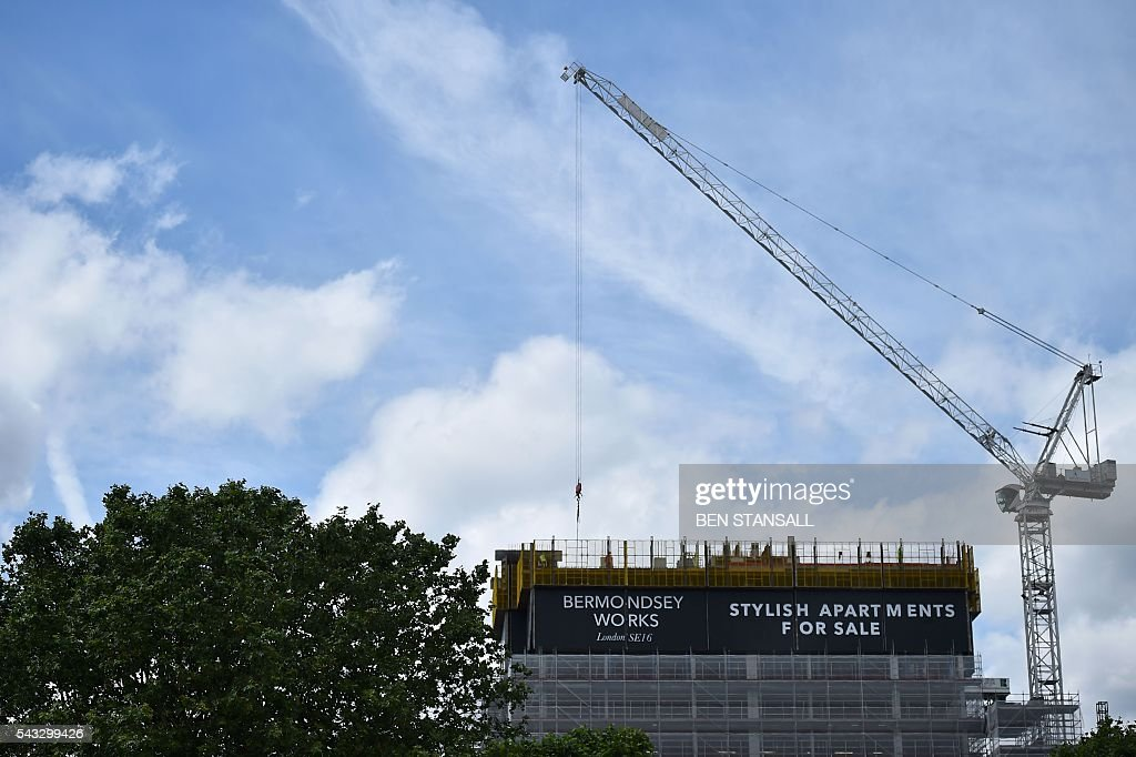 Residental construction is underway in south east London on June 27, 2016 Britain's historic decision to leave the 28-nation bloc has sent shockwaves through the political and economic fabric of the nation. It has also fuelled fears of a break-up of the United Kingdom with Scotland eyeing a new independence poll, and created turmoil in the opposition Labour party where leader Jeremy Corbyn is battling an all-out revolt. / AFP / Ben STANSALL