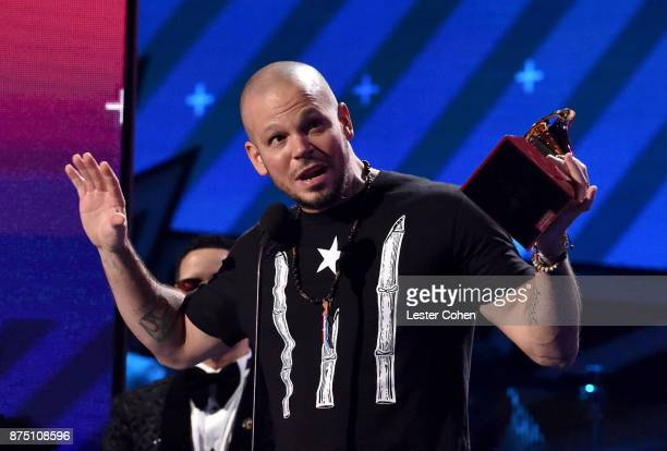 Residente accepts the award for Best Urban Song for 'Somos Anormales' onstage during The 18th Annual Latin Grammy Awards at MGM Grand Garden Arena on...