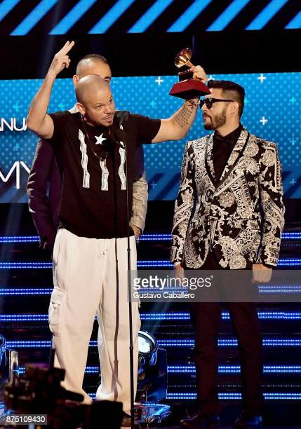 Residente accepts the Best Urban Song award for 'Somos Anormales' onstage during The 18th Annual Latin Grammy Awards at MGM Grand Garden Arena on...