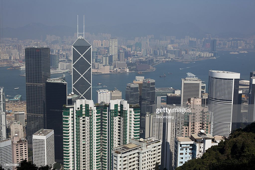 Residential and commercial buildings rise above the business district of Central as the Kowloon peninsula stands across Victoria Harbor in Hong Kong, China, on Thursday, Dec. 29, 2011. Hong Kong stocks fell today after a surge in lending by the European Central Bank underscored the scale of the region's debt crisis. Photographer: Jerome Favre/Bloomberg via Getty Images