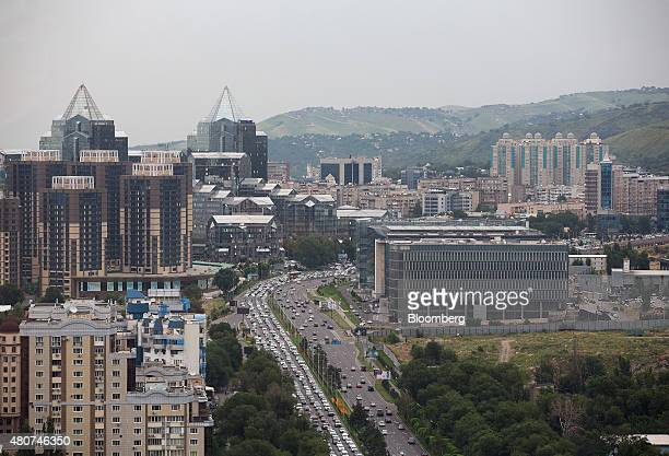 Residential and commercial buildings stand on the city skyline in Almaty Kazakhstan on Thursday June 25 2015 Kazakhstan's central bank widened the...