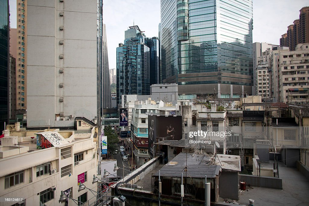 Residential and commercial properties stand in the Causeway Bay district of Hong Kong, China, on Monday, March 4, 2013. Hong Kong's Causeway Bay overtook New York's Fifth Avenue as the world's most expensive retail location last year, with annual average shop rents reaching $2,630 per square foot at the end of June, a 35 percent increase from a year earlier, according to property broker Cushman & Wakefield Inc. Photographer: Lam Yik Fei/Bloomberg via Getty Images