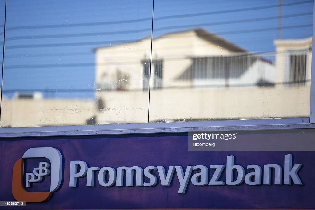 A residential apartment block is reflected in the window of a branch of the Russian OAO Promsvyazbank (PSB) bank in Limassol, Cyprus, on Tuesday, April 8, 2014. Cyprus is the biggest foreign investor in Russia with $69 billion dollars accumulated through the end of last year, while the island is the second-biggest destination for Russian investment at $33 billion, according to the Moscow-based Federal Statistics Service. Photographer: Andrew Caballero-Reynolds/Bloomberg via Getty Images