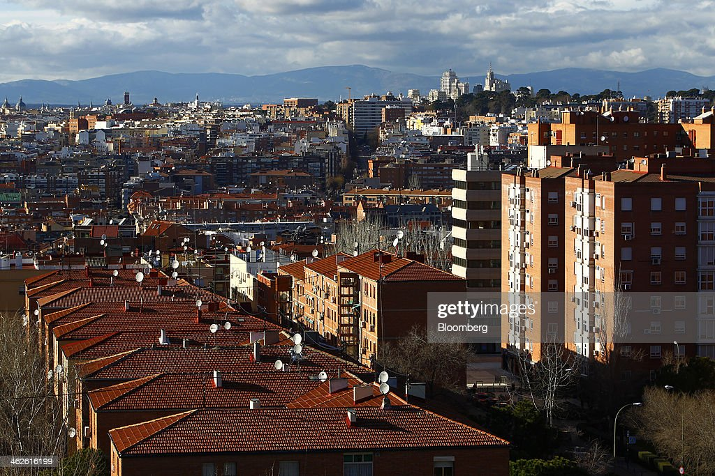 Residential apartment blocks and the rooftops of private housing stand on the city skyline in Madrid, Spain, on Saturday, Jan. 11, 2014. Spain's rental market is growing as government-spending cuts, a 26 percent jobless rate and subdued mortgage lending make home buying more difficult. Photographer: Angel Navarrete/Bloomberg via Getty Images
