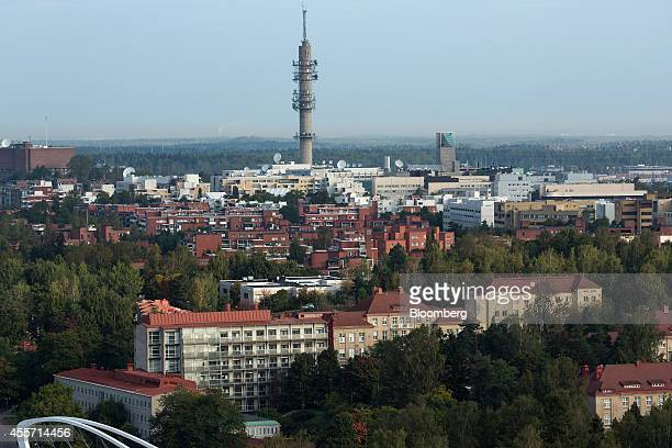 Residential apartment blocks stand on the city skyline beneath a telecommunications tower in Helsinki Finland on Friday Sept 19 2014 Finland can't...