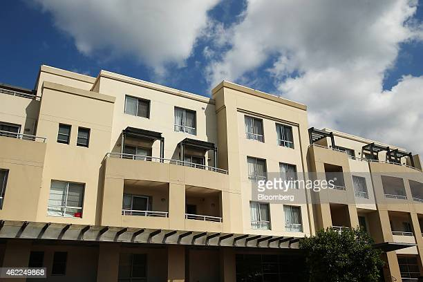 A residential apartment building stands in the suburb of Epping in Sydney Australia on Saturday Jan 24 2015 In Sydney a shortage of supply combined...