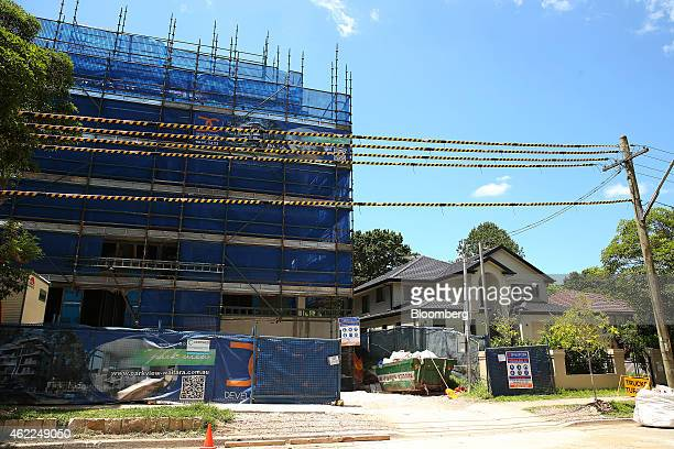 A residential apartment building stands under construction next to a detached house in the suburb of Waitara in Sydney Australia on Saturday Jan 24...