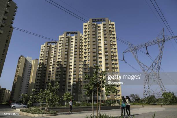 Residential apartment buildings stand in Palava City on the outskirts of Mumbai India on Thursday May 25 2017 Lodha Group best known for its luxury...