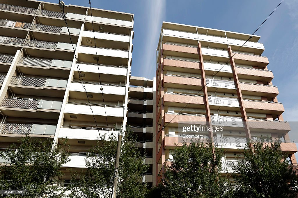 A residential apartment complex stands in Yokohama Japan on Tuesday Oct 20 2015 Asahi Kasei Corp said one of its units had falsified data for...