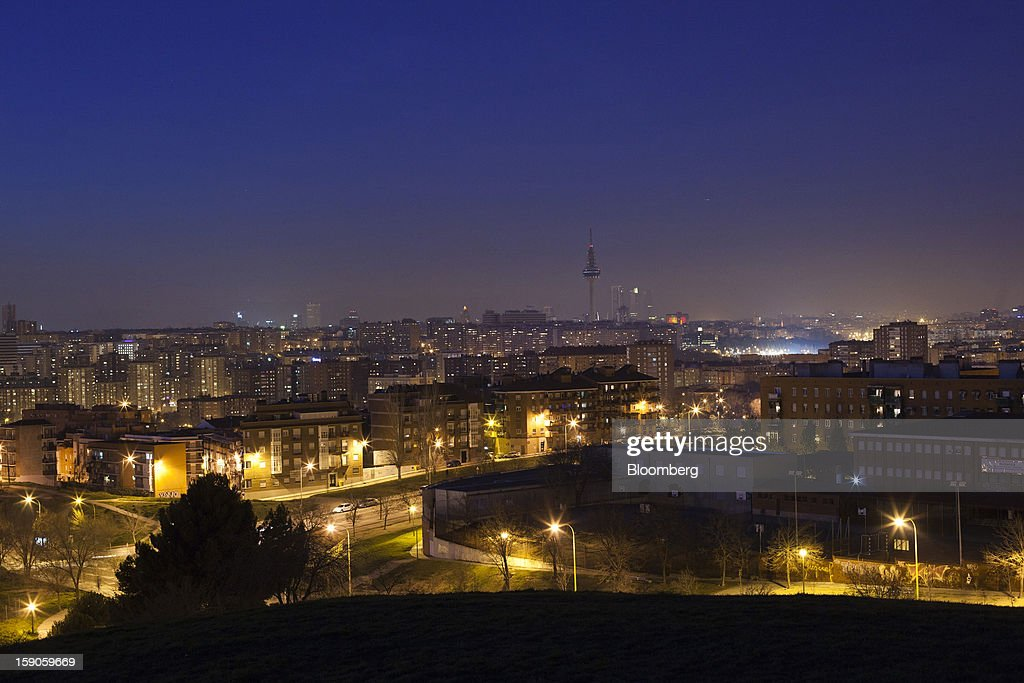 Residential apartments and city streets are seen illuminated at night by electric lights in Madrid, Spain, on Sunday, Jan. 6, 2013. In December, the Spanish parliament passed an energy law that imposed a 7 percent tax on electricity generation from Jan. 1 to plug the deficit. Photographer: Angel Navarrete/Bloomberg via Getty Images
