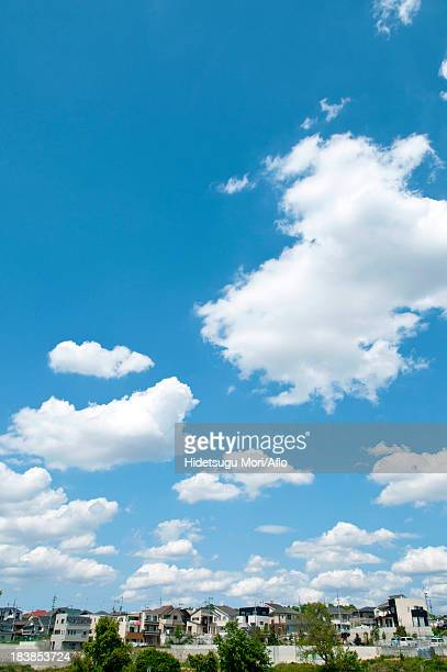 Residential area and blue sky with clouds
