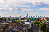 Residential area with flats in south London with a view of the city of London and its most iconic skyscrapers. Shot in Peckham, South London.