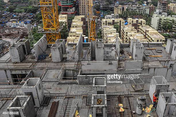 A residential building developed by Omkar Realtors Developers Pvt stands under construction in the Parel area of Mumbai India on Friday Aug 8 2014...