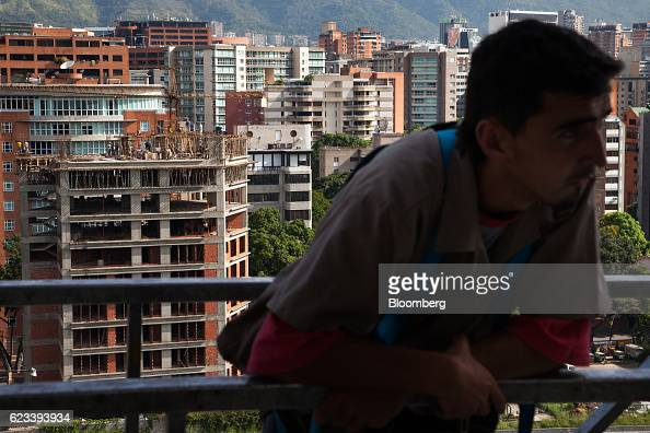 A residential building stands under construction behind a contractor in the El Rosal neighborhood of Caracas Venezuela on Wednesday Nov 9 2016 Some...