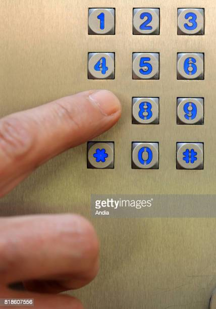 Residential building with secured access system door code with security camera and intercom man entering a code before getting to a building
