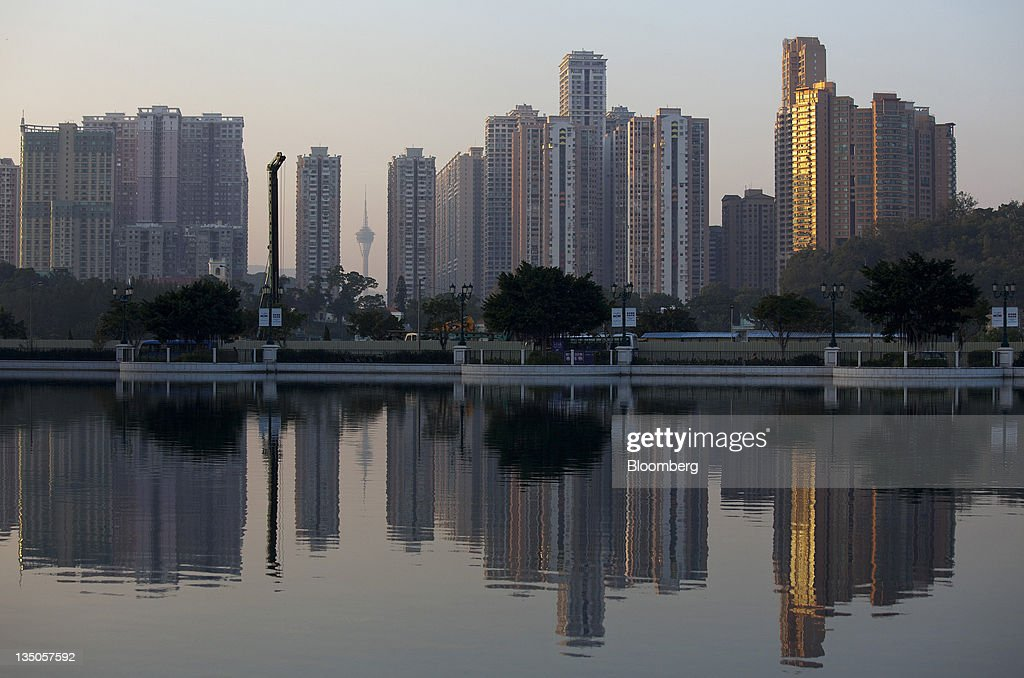 Residential buildings are reflected in water in Cotai, Macau, China, on Sunday, Dec. 4, 2011. Macau casino gambling revenue climbed a better-than-expected 33 percent last month as economic growth stoked demand from visitors from China's mainland. Photographer: Jerome Favre/Bloomberg via Getty Images