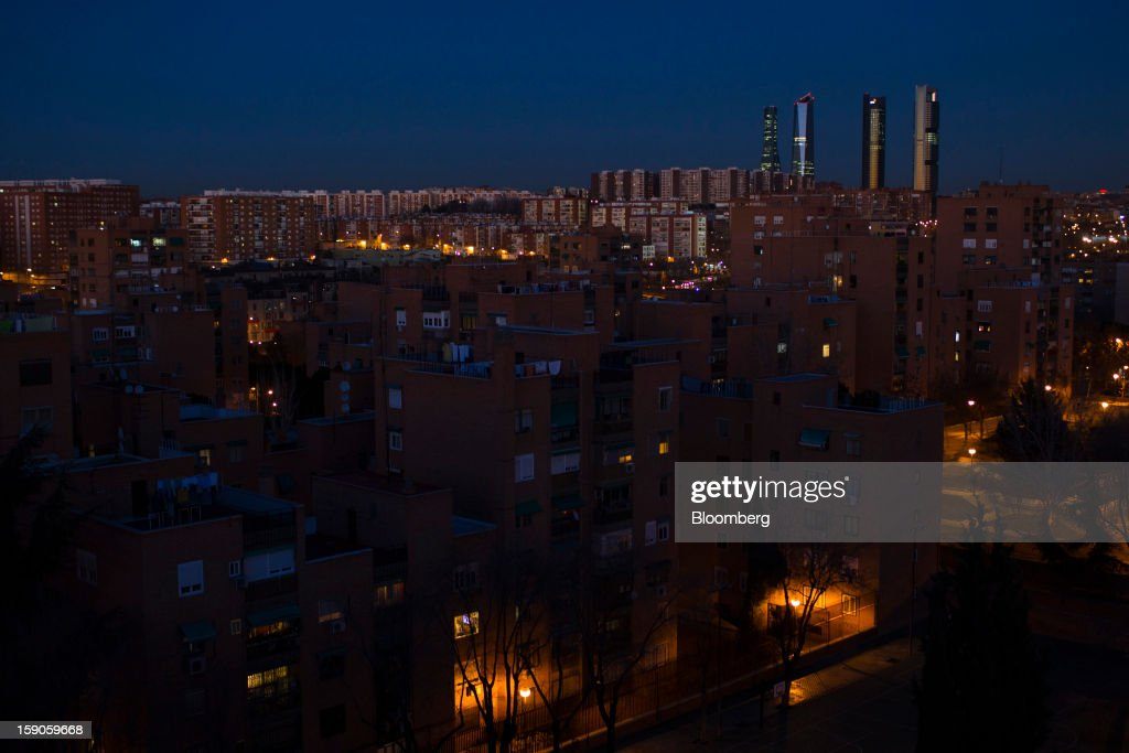 Residential buildings are seen illuminated by electric lights at night on the skyline of Madrid, Spain, on Friday, Jan. 4, 2013. In December, the Spanish parliament passed an energy law that imposed a 7 percent tax on electricity generation from Jan. 1 to plug the deficit. Photographer: Angel Navarrete/Bloomberg via Getty Images