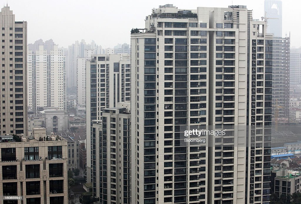 Residential buildings stand at Casa Lakeville, a residential property developed by Shui On Land Ltd., in Shanghai, China, on Wednesday, Feb. 6, 2013. China's economic growth accelerated for the first time in two years as government efforts to revive demand drove a rebound in industrial output, retail sales and the housing market. Photographer: Tomohiro Ohsumi/Bloomberg via Getty Images
