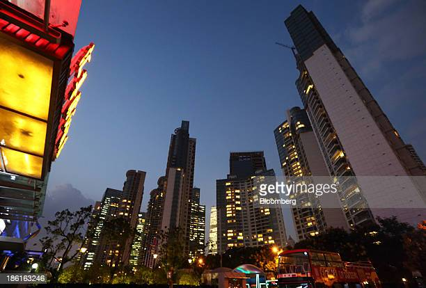Residential buildings stand at night in the Pudong area of Shanghai China on Tuesday Oct 22 2013 China's economic expansion accelerated to 78 percent...