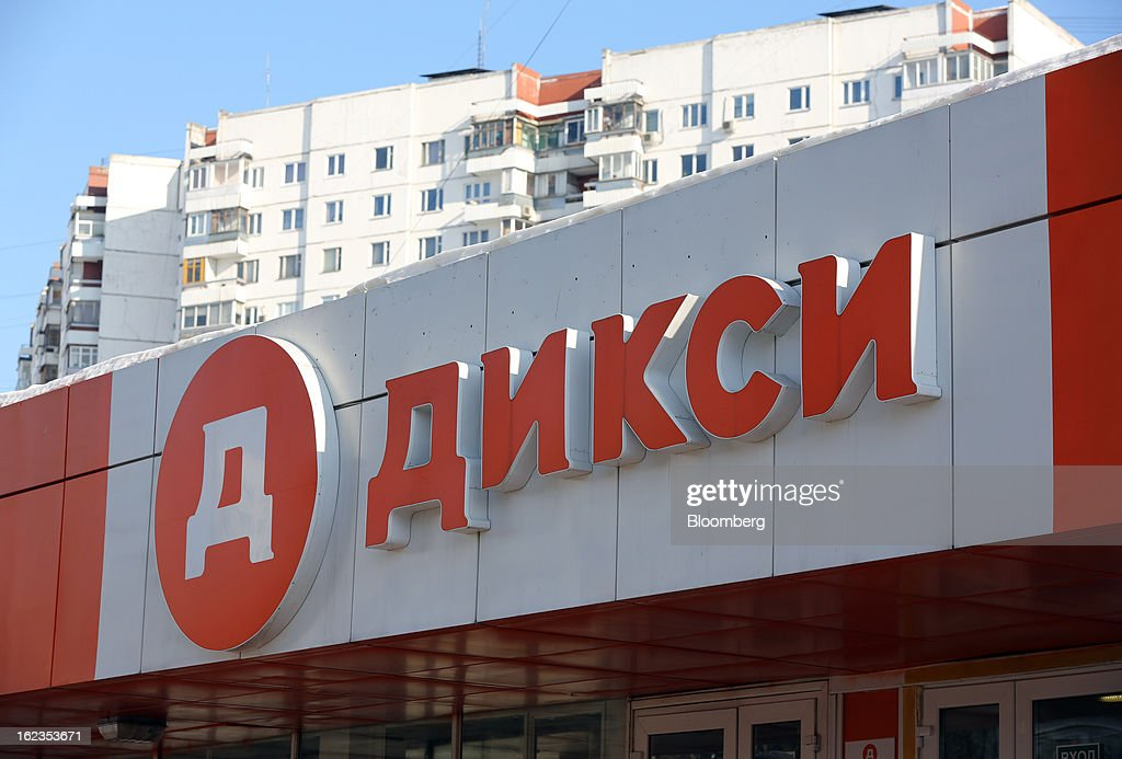 Residential buildings stand behind a supermarket operated by OAO Dixy Group in Moscow, Russia, on Friday, Feb. 22, 2013. Russia's largest retailer by market value, OAO Magnit, is spending as much as $1.8 billion this year to compete against X5 Retail Group NV and OAO Dixy Group. Photographer: Andrey Rudakov/Bloomberg via Getty Images