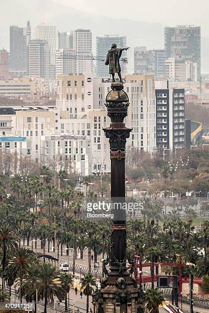 Residential buildings stand beyond a statue on the city skyline in Barcelona Spain on Friday Feb 21 2014 A smart city initiative which also involves...