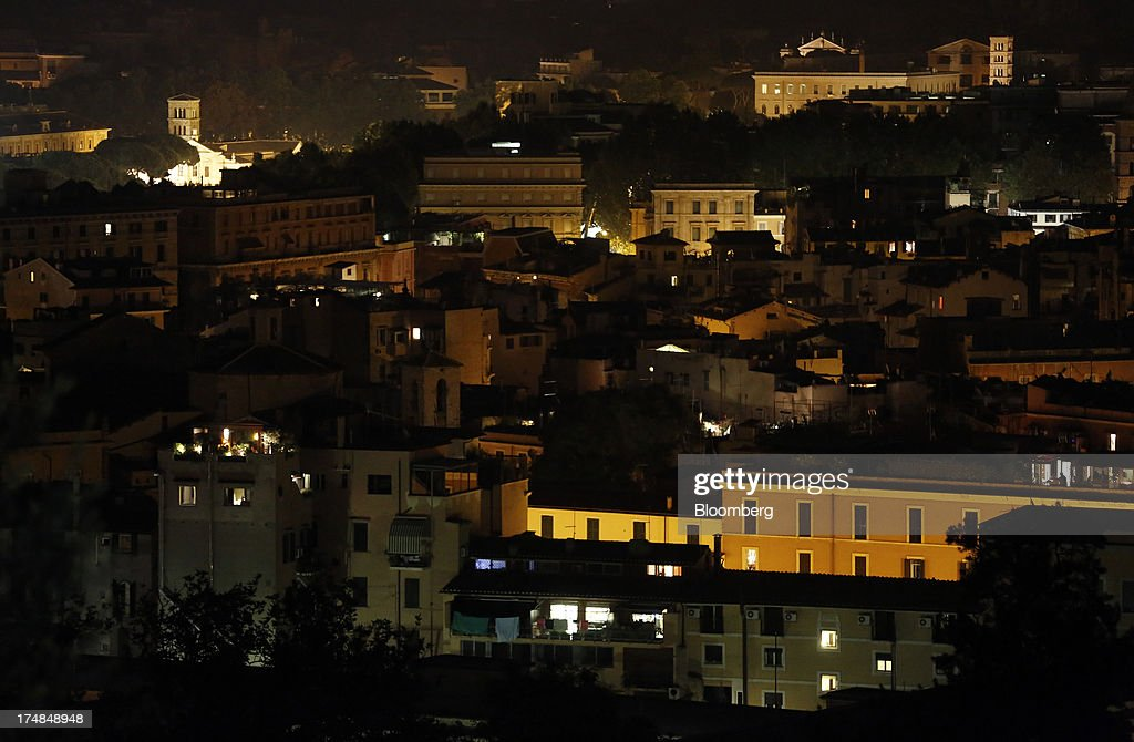 Residential buildings stand illuminated at night in central Rome, Italy, on Saturday, July 27, 2013. Italy's home prices are low enough to trigger an increase in purchases for the first time since 2006, though that won't lift values for at least two years, according to the Nomisma institute. Photographer: Alessia Pierdomenico/Bloomberg via Getty Images