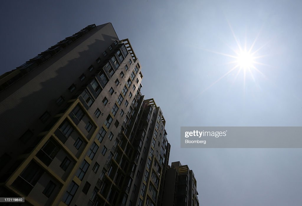 Residential buildings stand in Shanghai, China, on Sunday, June 30, 2013. China's President Xi Jinping said officials shouldn't be judged solely on their record in boosting gross domestic product, the latest signal that policy makers are prepared to tolerate slower economic expansion. Photographer: Tomohiro Ohsumi/Bloomberg via Getty Images