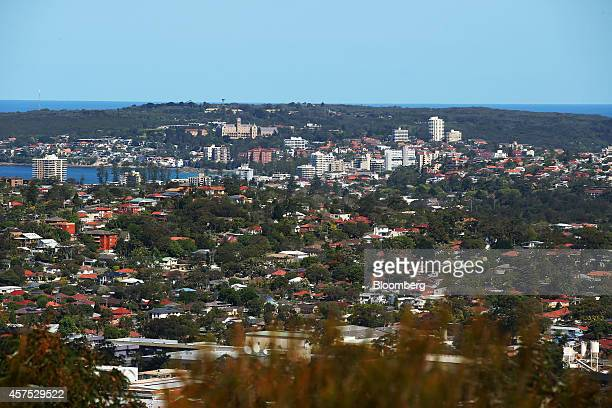 Residential buildings stand in the Northern Beaches area of Sydney Australia on Saturday Oct 18 2014 Sydneys median home price rose 14 percent from a...