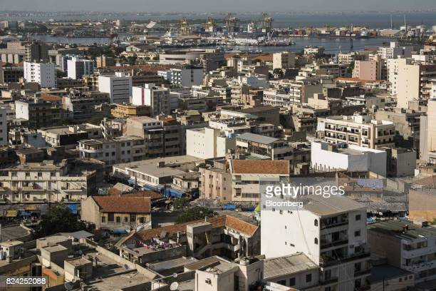 Residential buildings stand in the Plateau district with the Port of Dakar in the distance in Dakar Senegal on Friday July 28 2017 Senegalese voters...