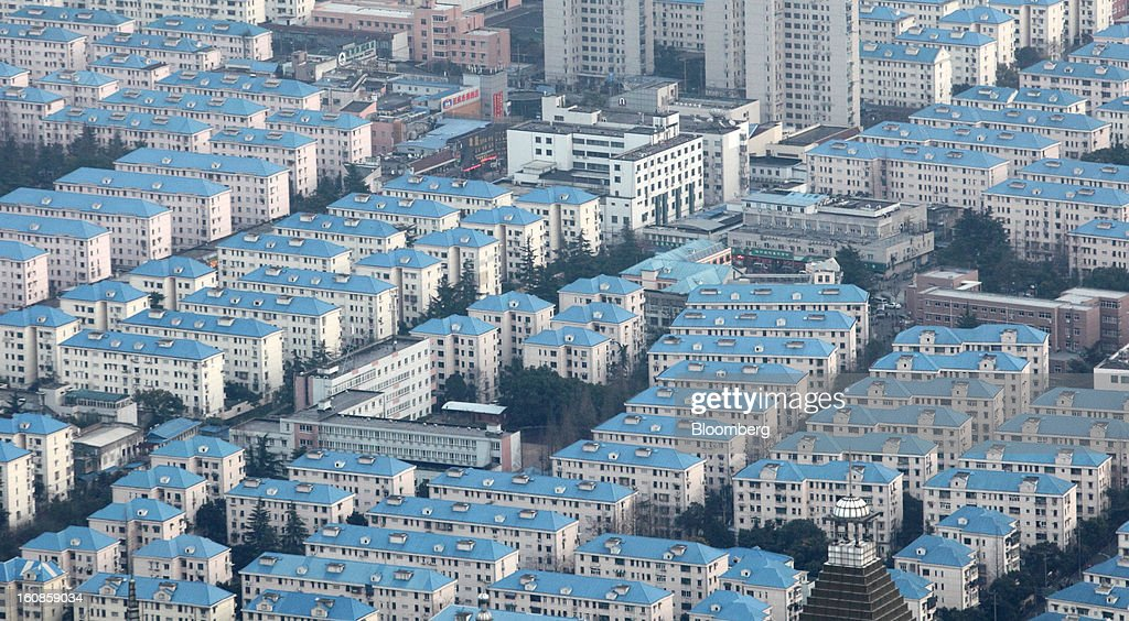 Residential buildings stand in the Pudong area of Shanghai, China, on Saturday, Feb. 2, 2013. China's economic growth accelerated for the first time in two years as government efforts to revive demand drove a rebound in industrial output, retail sales and the housing market. Photographer: Tomohiro Ohsumi/Bloomberg via Getty Images