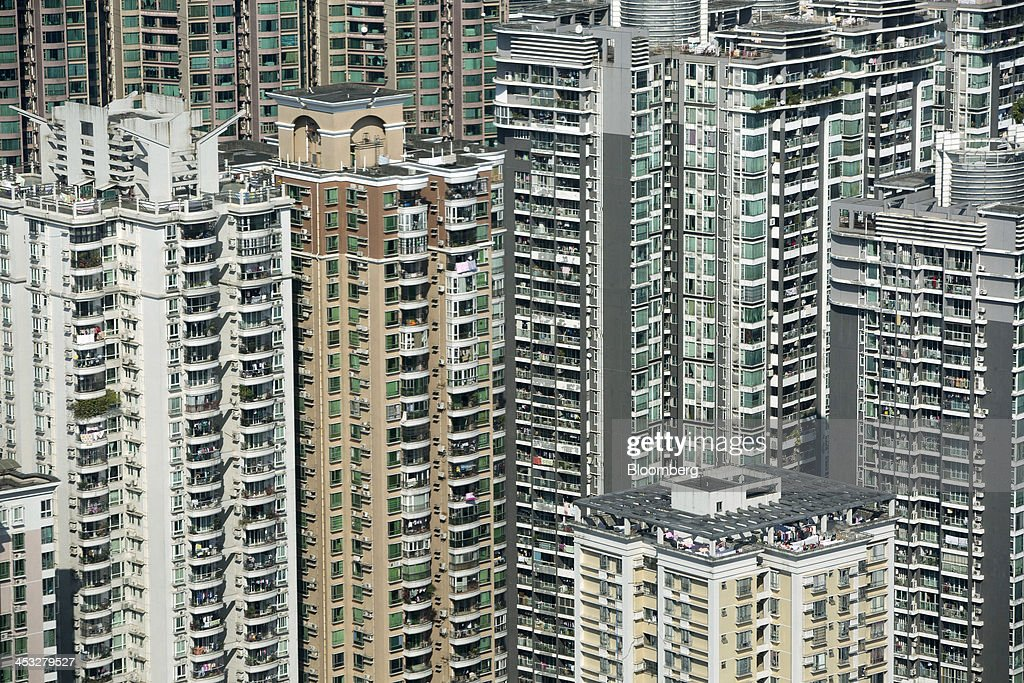 Residential buildings stand in the Tianhe district of Guangzhou, China, on Saturday, Nov. 30, 2013. China's government may set its 2014 growth target at 7 percent, the Economic Information Daily reported on Dec. 3, citing the State Information Center. This compares with a goal of 7.5 percent for this year. Photographer: Brent Lewin/Bloomberg via Getty Images