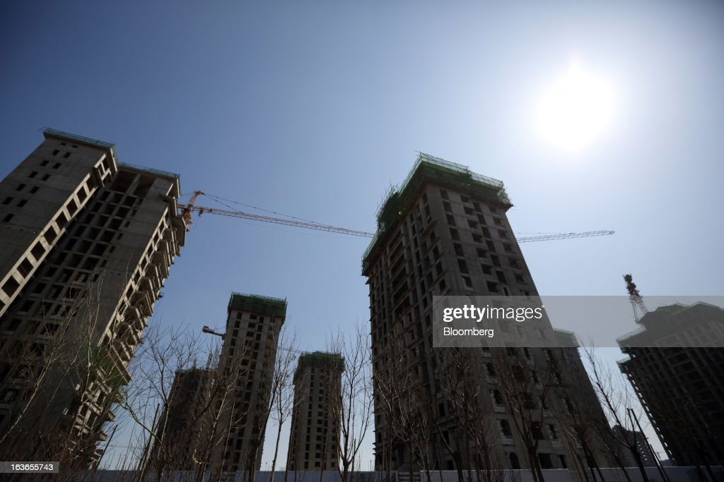 Residential buildings stand under construction at the Sino-Singapore Tianjin Eco-city in Tianjin, China, on Wednesday, March 13, 2013. China's money-market rate rose to a one-week high after central bank Governor Zhou Xiaochuan said yesterday the nation should be on 'high alert' over inflation. Photographer: Tomohiro Ohsumi/Bloomberg via Getty Images