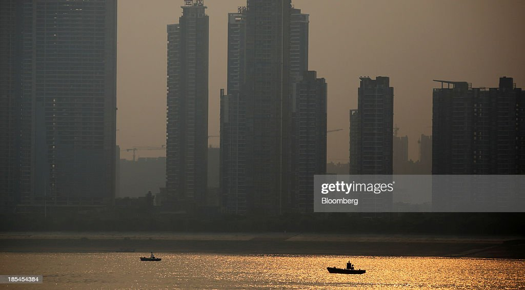 Residential buildings stand under construction beside the Chang Jiang river in Wuhan, China, on Sunday, Oct. 20, 2013. China's economic expansion accelerated to 7.8 percent in the third quarter from a year earlier, the statistics bureau said Oct. 18, reversing a slowdown that put the government at risk of missing its 7.5 percent growth target for 2013. Photographer: Tomohiro Ohsumi/Bloomberg via Getty Images