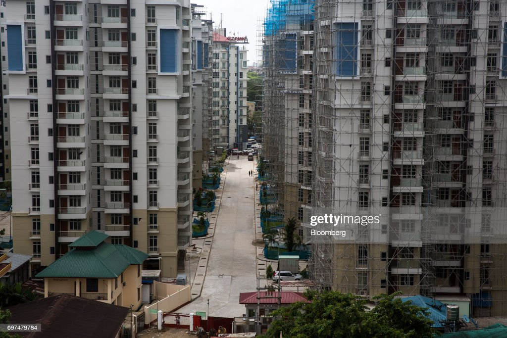 Residential buildings stand under construction in Yangon, Myanmar, on Monday, June 12, 2017. When the country opened to the outside world in 2011 after decades of military rule, the former British colony held promise as one of the worlds hottest tourist destinations, a last frontier for adventure travel.But it hasn't worked out that way. A construction glut has flooded Myanmar with unused hotel rooms, and poorly regulated building has damaged national treasures like the archaeological site of Bagan. Photographer: Taylor Weidman/Bloomberg via Getty Images