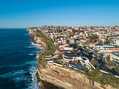 Aerial view of residential area across rock cliff area in Sydney coastline