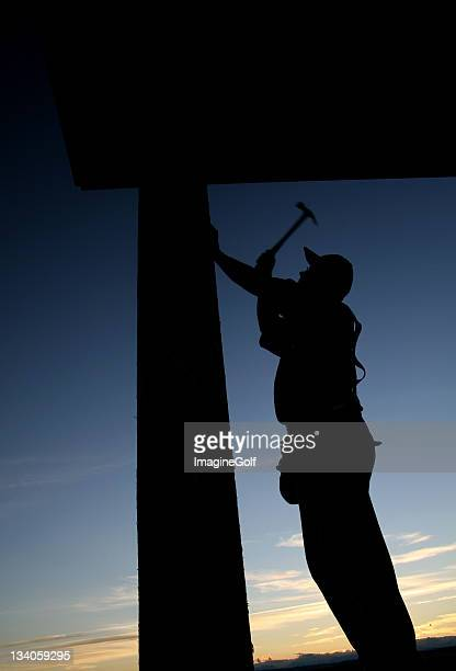 Residential Construction Worker Framing a House
