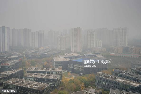 A residential district is blanketed by heavy smog on November 12 2015 in Beijing China Air pollution in north China is heavier as people start to use...