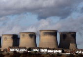 Residential homes sit in front of the coal fueled Ferrybridge power station as it generates electricity on November 17 2009 in Ferrybridge United...