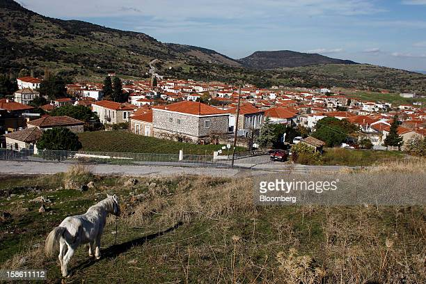 Residential homes stand in a town on the northern part of the island where immigrants from the Turkish mainland arrive along the coast in Mantamados...