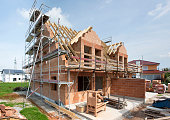 framework of new built roof on residential house in construction