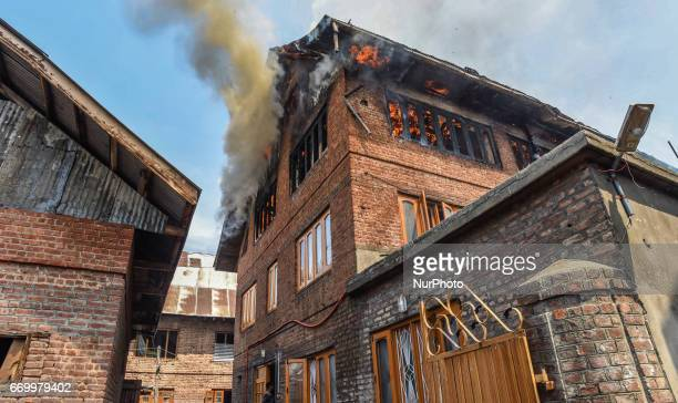 A residential house is seen engulfed in flames on APRIL 18 2017 in Srinagar the summer capital of Indian administered Kashmir India A residential...